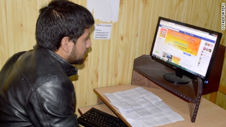 Nafees Ahmad, a Kashmiri youth browses the Lalla Ded Charity website to register as a volunteer.
