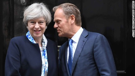 British Prime Minister Theresa May, left, greets European Council President Donald Tusk outside 10 Downing street in central London on April 6.