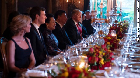 TOPSHOT - US President Donald Trump (C) and Chinese President Xi Jinping (L) look on during dinner at the Mar-a-Lago estate in West Palm Beach, Florida, on April 6, 2017. / AFP PHOTO / JIM WATSON        (Photo credit should read JIM WATSON/AFP/Getty Images)