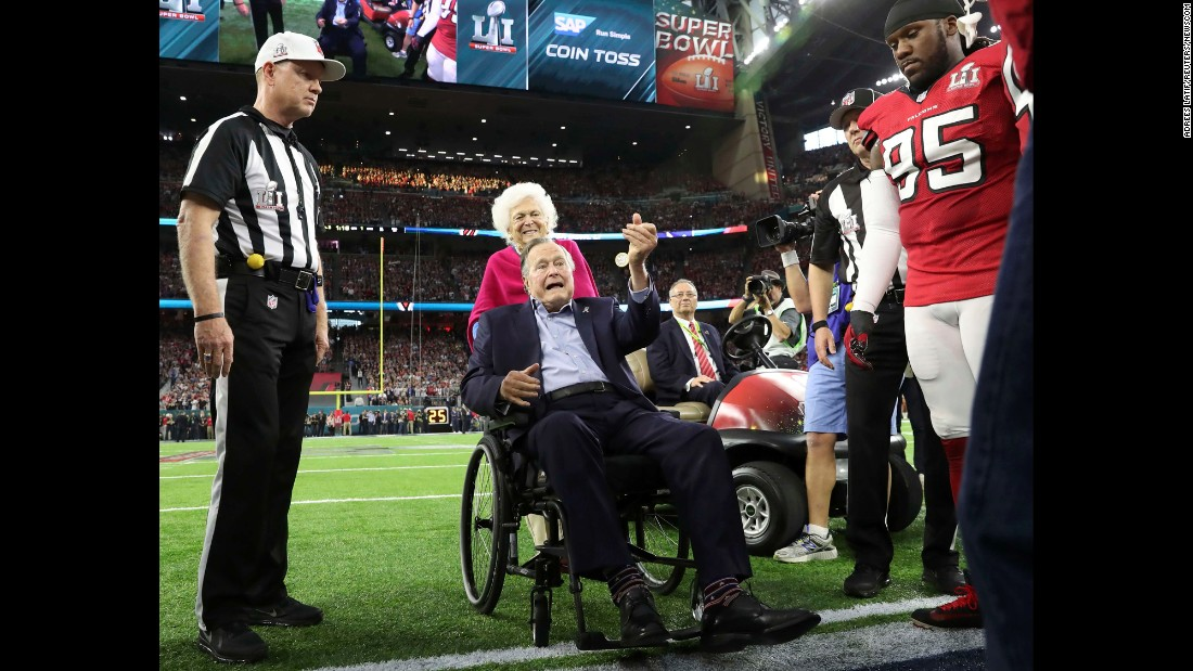 Former US President George H.W. Bush and former first lady Barbara Bush participate in the coin toss before Super Bowl LI between the New England Patriots and the Atlanta Falcons on February 5, 2017.
