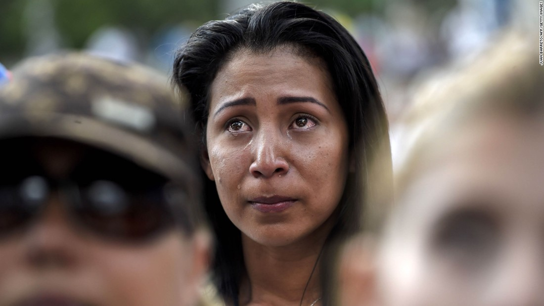 A demonstrator reacts during a march in Caracas on Saturday, April 15.