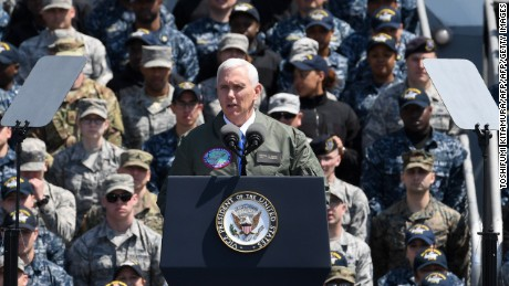US Vice President Mike Pence delivers a speech before US and Japanese soldiers onboard USS Ronald Reagan at the US Naval base in Yokosuka on April 19, 2017. / AFP PHOTO / Toshifumi KITAMURA        (Photo credit should read TOSHIFUMI KITAMURA/AFP/Getty Images)