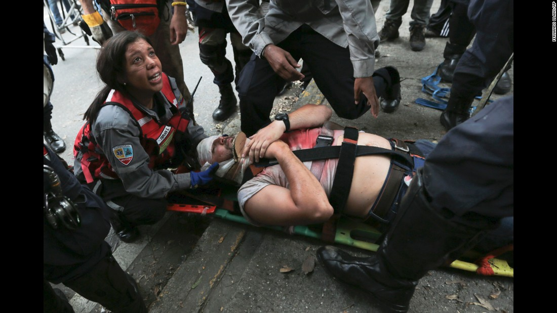 Rescue workers tend to a demonstrator hit by a tear gas canister during anti-government protests on April 19.
