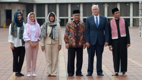 "US Vice President Mike Pence (2nd R), his wife Karen (3rd L) and their daughters Charlotte (2nd L) and Audrey (L), Muhammad Muzammil Basyuni (3rd R) and Nasarudin Umar (R) from the Istiqlal mosque pose for a photo at the Istiqlal grand mosque in Jakarta on April 20, 2017.  US Vice President Mike Pence on April 20 praised Indonesia's moderate form of Islam as ""an inspiration"" at the start of a visit to the Muslim-majority country seen as a bid by his administration to heal divisions with the Islamic world. / AFP PHOTO / POOL / Adek BERRY        (Photo credit should read ADEK BERRY/AFP/Getty Images)"