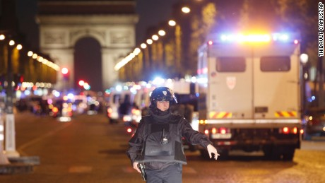 A police officer stands guard after a fatal shooting  on the Champs-Elysees in Paris.