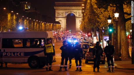 Police seal off the Champs Elysees avenue in Paris, France, after a fatal shooting in which a police officer was killed along with an attacker, Thursday, April 20, 2017. French media are reporting that two police officers were shot Thursday on the famed shopping boulevard. Many police vehicles can be seen on the avenue that passes many of the city's most iconic landmarks. (AP Photo/Kamil Zihnioglu)
