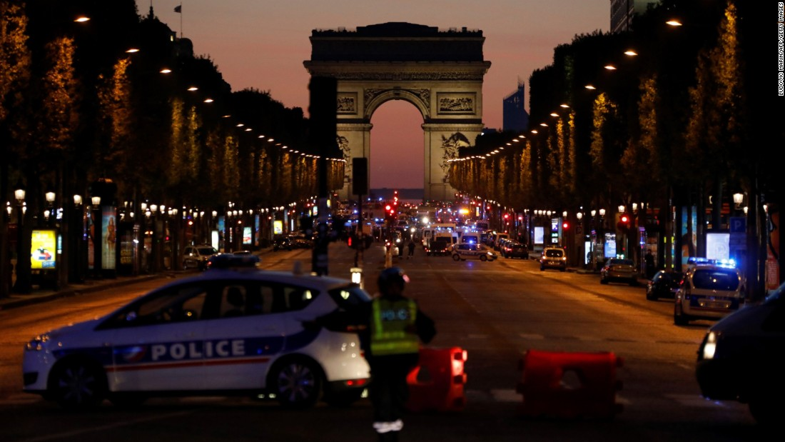 "Police officers block access to the Champs-Elysees in Paris <a href=""http://www.cnn.com/2017/04/20/europe/champs-elyses-in-paris-closed/index.html"" target=""_blank"">after a shooting</a> on Thursday, April 20. One police officer and the attacker were killed. The suspect was known to French security services for radical Islamist activities, a source close to the investigation told CNN."