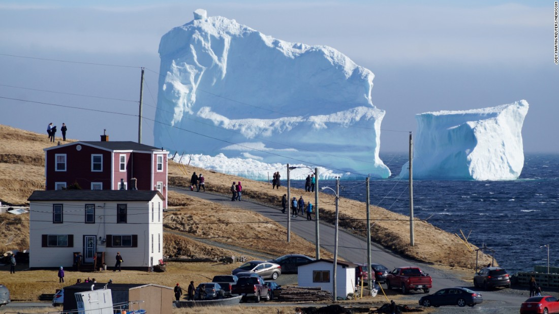 "Residents view the first iceberg of the season on Sunday, April 16, as it passes the South Shore, also known as <a href=""http://www.cnn.com/2017/04/19/travel/ferryland-iceberg-trnd/index.html"" target=""_blank"">""Iceberg Alley,""</a> near Ferryland, Newfoundland and Labrador."