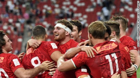 Isaac Kaay (C) of Canada celebrates with teammates after victory against the US team in the cup final of the Singapore Rugby Sevens tournament in Singapore on April 16, 2017.  / AFP PHOTO / ROSLAN RAHMAN        (Photo credit should read ROSLAN RAHMAN/AFP/Getty Images)