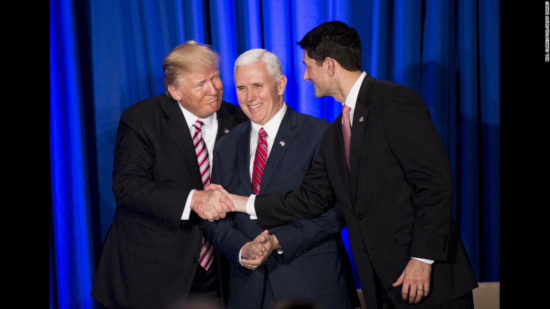 "Trump and House Speaker Paul Ryan shake hands in front of Vice President Pence during a luncheon with GOP lawmakers on January 26. Trump <a href=""http://www.cnn.com/2017/01/26/politics/donald-trump-hill-gop-retreat/"" target=""_blank"">previewed an ambitious governing agenda</a> during his speech. ""This Congress is going to be the busiest Congress we've had in decades, maybe ever,"" he said. ""This is our chance to achieve great and lasting change for our beloved nation."""