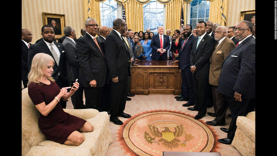 "White House Adviser Kellyanne Conway takes an Oval Office photo of Trump and leaders of historically black colleges and universities on Monday, February 27. The image of her kneeling on the couch <a href=""http://www.cnn.com/videos/politics/2017/02/28/kellyanne-conway-oval-couch-photo-orig-vstan.cnn"" target=""_blank"">sparked memes on social media.</a>"