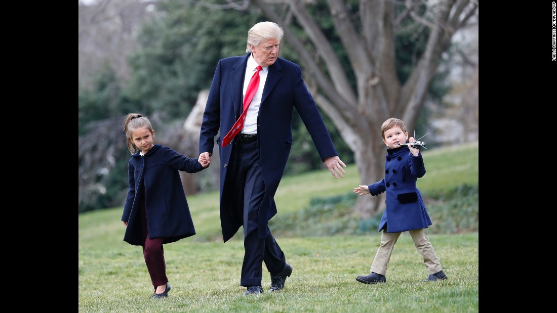 The President and his grandchildren Arabella and Joseph walk across the South Lawn of the White House on Friday, March 3. They were about to board Marine One for a short flight to Andrews Air Force Base.