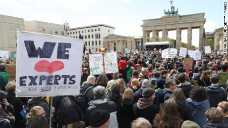 Crowds converge Saturday in front of the Brandenburg Gate in Berlin support of scientific research.