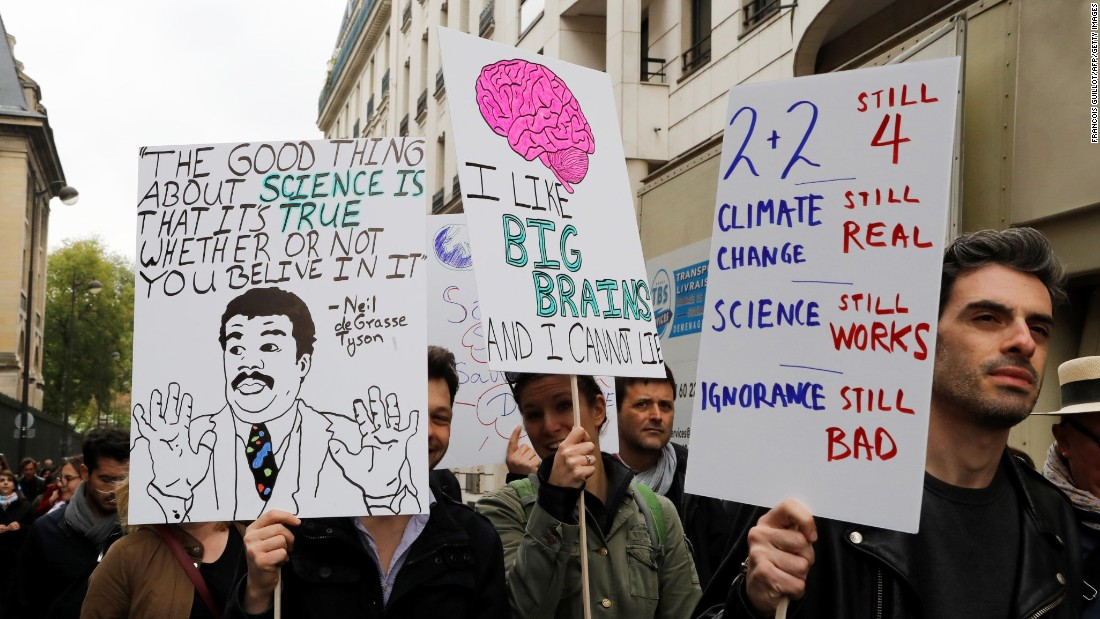 Marchers at the Paris March for Science holding signs. In addition to Paris and Berlin, marches were schedued in Rio, Munich, San Francisco, Boston, Oklahoma City and Bratislava, Slovakia.