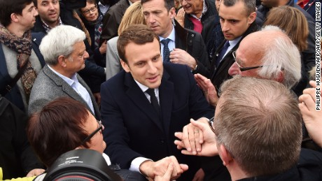 French presidential election candidate for the En Marche ! movement Emmanuel Macron shakes hands with supporters after voting at a polling station in Le Touquet, northern France, on April 23, 2017, during the first round of the Presidential election. / AFP PHOTO / Philippe HUGUEN        (Photo credit should read PHILIPPE HUGUEN/AFP/Getty Images)