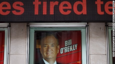 NEW YORK, NY - APRIL 19: Advertisements for Fox News and Bill O'Reilly stand in a window outside of the News Corp. and Fox News headquarters in Midtown Manhattan, April 19, 2017 in New York City. 21st Century Fox, the parent company of Fox News, announced on Wednesday that Fox News television personality Bill O'Reilly will not be returning to the network following numerous claims of sexual harassment and subsequent legal settlements. (Photo by Drew Angerer/Getty Images)