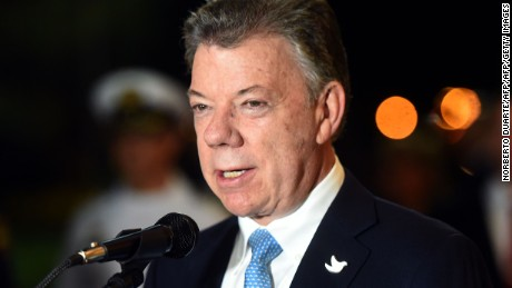 Colombia's President Juan Manuel Santos speaks upon arrival at the Silvio Pettirossi international airport in Luque, Paraguay on April 23, 2017, for a two-day official visit / AFP PHOTO / NORBERTO DUARTE        (Photo credit should read NORBERTO DUARTE/AFP/Getty Images)