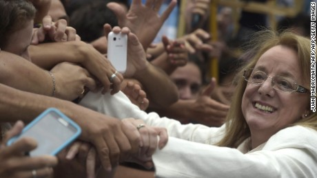 Social Developement Minister Alicia Kirchner is greeted by supporters after Argentine President Cristina Fernandez de Kirchner delivered a speech during the inauguration of the 133th period of ordinary sessions at the Congress in Buenos Aires, Argentina on March 1, 2015.  AFP PHOTO / JUAN MABROMATA        (Photo credit should read JUAN MABROMATA/AFP/Getty Images)