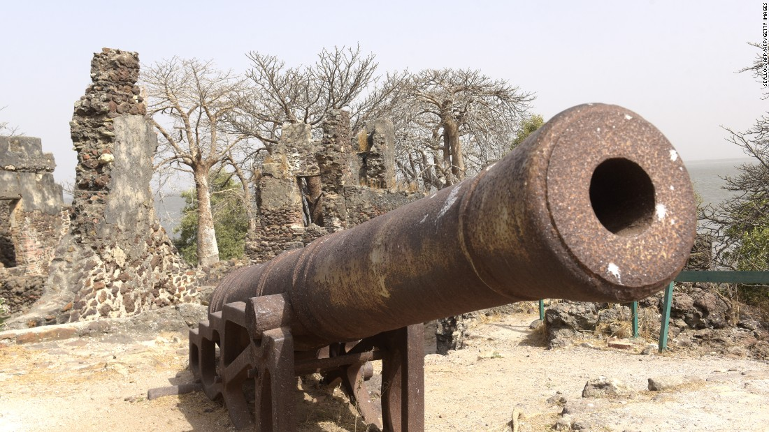 A rusted cannon on the beach of Kunta Kinteh Island, formerly James Island, in the Gambia River. <br /><br />The island was a longtime hub of the Atlantic slave trade, and famous rebel slave Kunta Kinte was once held there.
