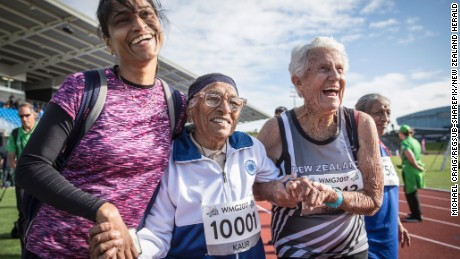 Centenarian Man Kaur, 101, and her admirers celebrate her win in the 100m race at the 2017 World Masters Games in Auckland.