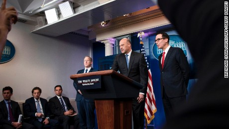 White House Press Secretary Sean Spicer (L), National Economic Council Director Gary Cohn (C) and US Secretary of the Treasury Steven Mnuchin take questions about tax cuts and reform during a briefing at the White House April 26, 2017 in Washington, DC.   (Photo credit should read BRENDAN SMIALOWSKI/AFP/Getty Images)