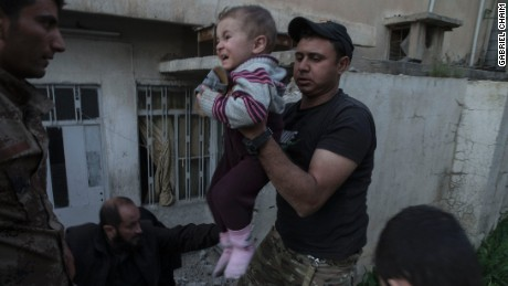 Iraqi special forces assist civilians out of their homes as heavy clashes between Iraq special forces and ISIS raged on in west Mosul's al Yarmouk neighborhood on April 9.