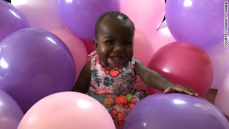 Baby Dominique celebrating her first birthday early.