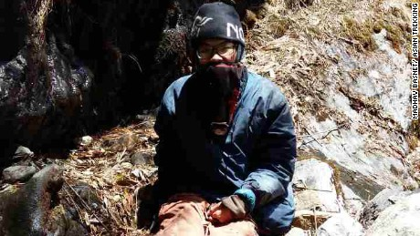 "Taiwanese hiker Liang Sheng-yue, seen at the site of his rescue. He was conscious when the search party found him, but ""very tired,"" and had lost 30 kg over the 47 days in the wilderness."