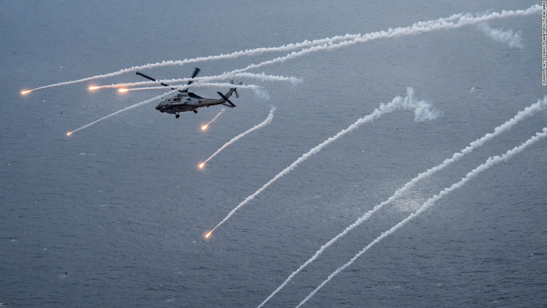 "A US Navy helicopter fires flares during a training exercise in the Philippine Sea on Monday, April 24. The helicopter was near the USS Carl Vinson, <a href=""http://www.cnn.com/2017/04/08/politics/navy-korean-peninsula/"" target=""_blank"">which was headed to the Korean Peninsula</a> in response to North Korean provocations, a US defense official told CNN."