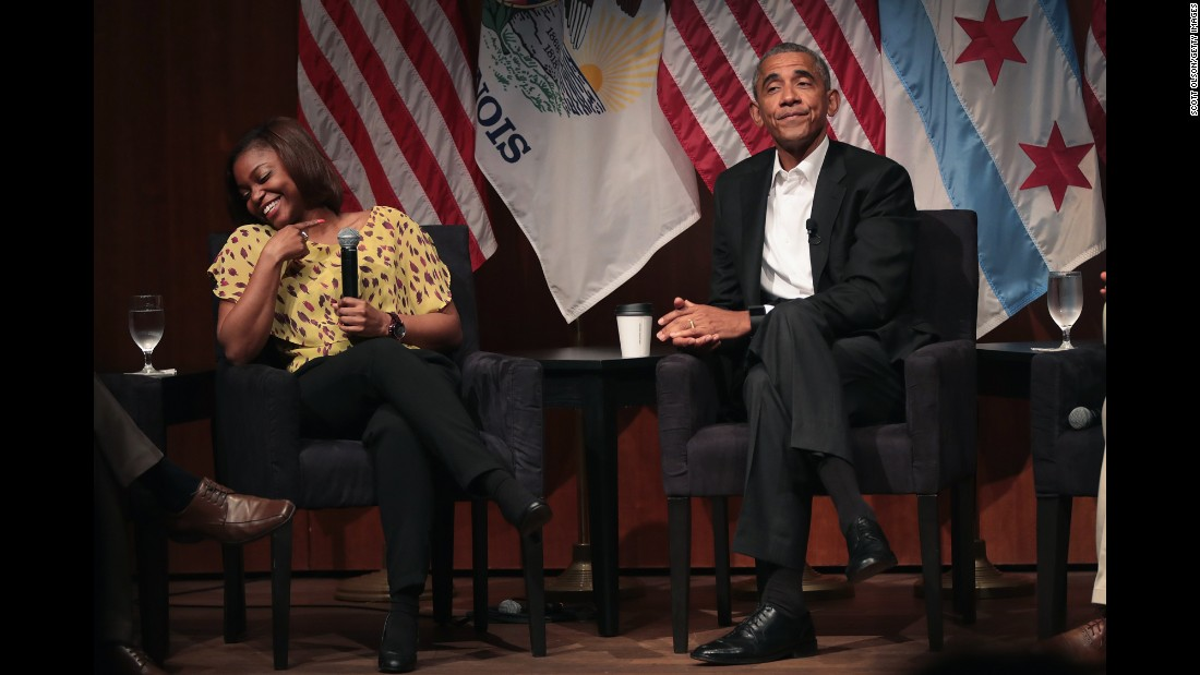 "Pharmacist Tiffany Brown laughs with former US President Barack Obama as they attend a forum at the University of Chicago on Monday, April 24. It was Obama's first public appearance since leaving the White House three months ago. <a href=""http://www.cnn.com/2017/04/24/politics/obama-first-public-speaking/"" target=""_blank"">See what Obama said</a>"