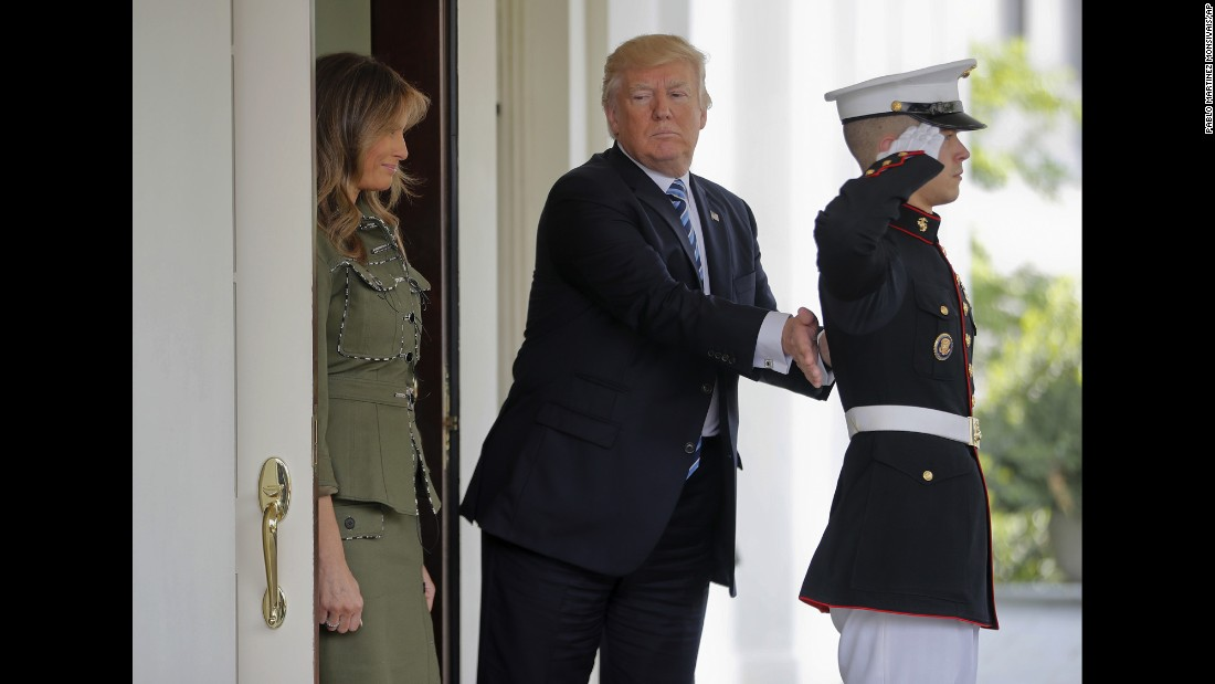 President Donald Trump pats a US Marine on the back after he and the first lady walked Argentina's President and his wife to their vehicle on Thursday, April 27.