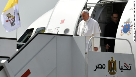 "Pope Francis disembarks from his plane upon his arrival at Cairo's International Airport on April 28, 2017, during an official visit to Egypt. Pope Francis began a visit to Egypt to promote ""unity and fraternity"" among Muslims and the embattled Christian minority that has suffered a series of jihadist attacks. / AFP PHOTO / Andreas SOLARO        (Photo credit should read ANDREAS SOLARO/AFP/Getty Images)"