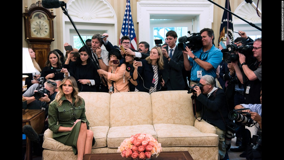 Trump listens while her husband speaks to the press in the White House Oval Office on Thursday, April 27.