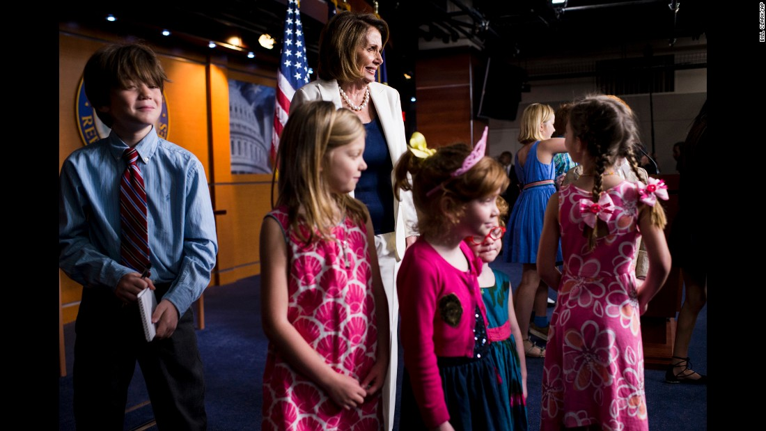 House Minority Leader Nancy Pelosi poses with journalists' children at the end of her weekly news conference in Washington on Thursday, April 27. It was national Take Our Daughters and Sons to Work Day, and many journalists brought their children to the US Capitol.