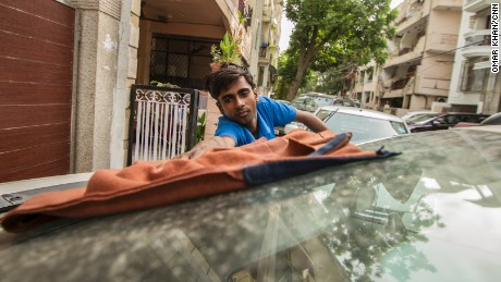 Shambhu still washes cars every morning to help his family earn a living.