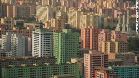 A photo taken on July 17, 2016 shows apartment buildings and the Monument to the Founding of the Workers Party (centre R) amongst the Pyongyang skyline, seen from a viewing deck of the landmark Tower of the Juche Idea. / AFP / KIM WON-JIN        (Photo credit should read KIM WON-JIN/AFP/Getty Images)