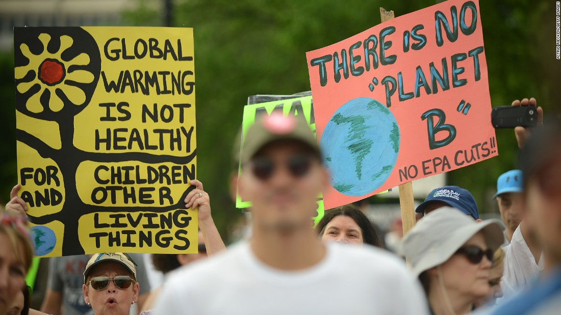 Climate protest takes on Trump's policies -- and the heat -- in DC march