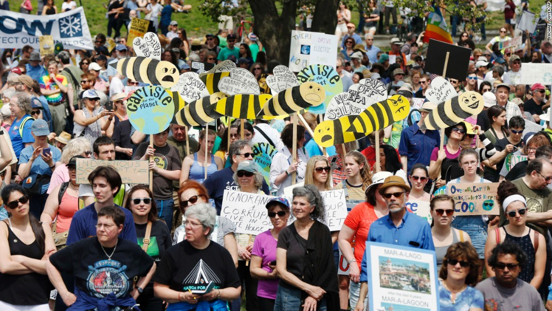People take part in Boston's climate rally.