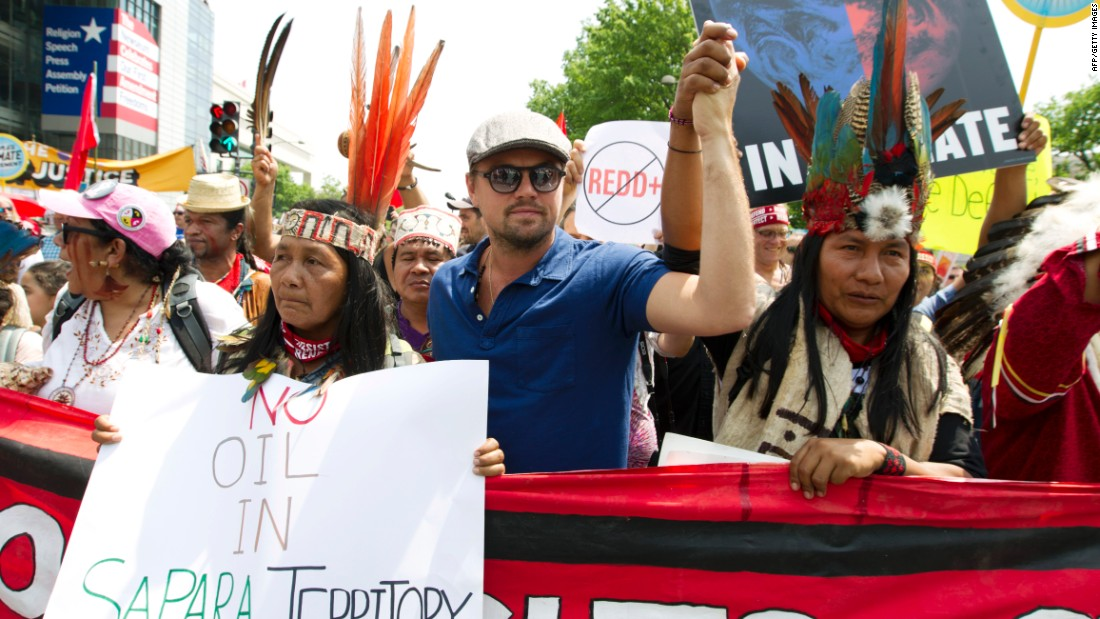 Actor Leonardo DiCaprio marches in Washington with a group of indigenous people from North and South America.
