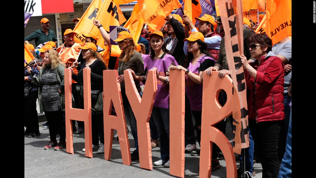 "Protesters in Ankara, Turkey, stand behind the word ""hayir,"" which means ""no"" in Turkish. Many May Day rallies called for better pay and working conditions."