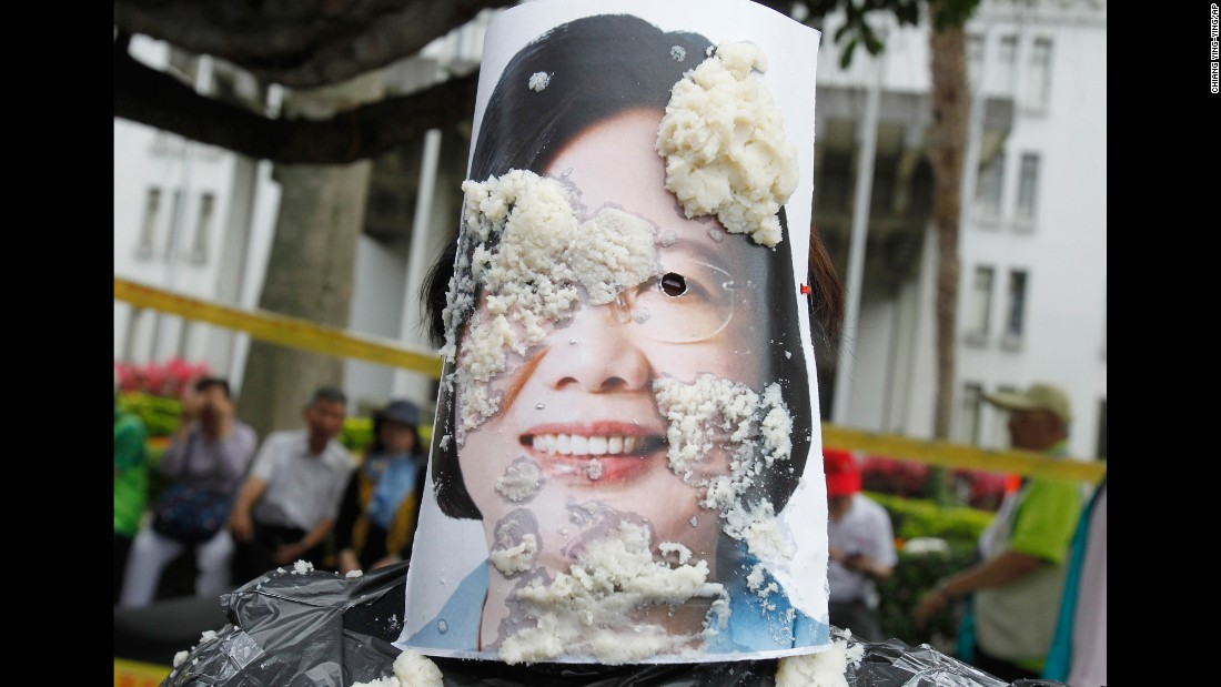 Bean curd covers a picture of acting Taiwanese President Tsai Ing-wen during a rally in Taipei.
