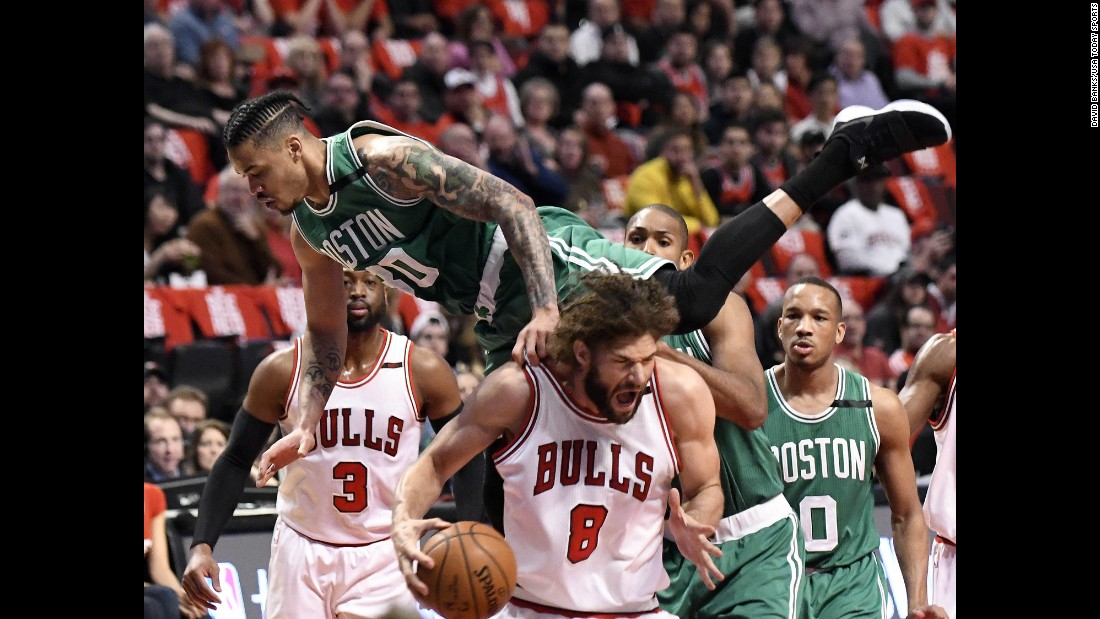 Boston's Gerald Green falls on Chicago's Robin Lopez during an NBA playoff game on Friday, April 28.