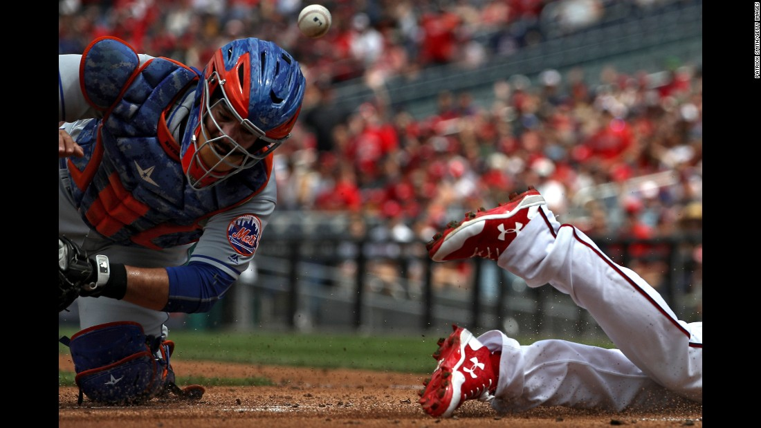 New York Mets catcher Rene Rivera can't come up with the ball to tag Washington's Anthony Rendon on Sunday, April 30. Rendon went 6-for-6 -- with three home runs and 10 RBIs -- as the Nationals crushed the Mets 23-5.