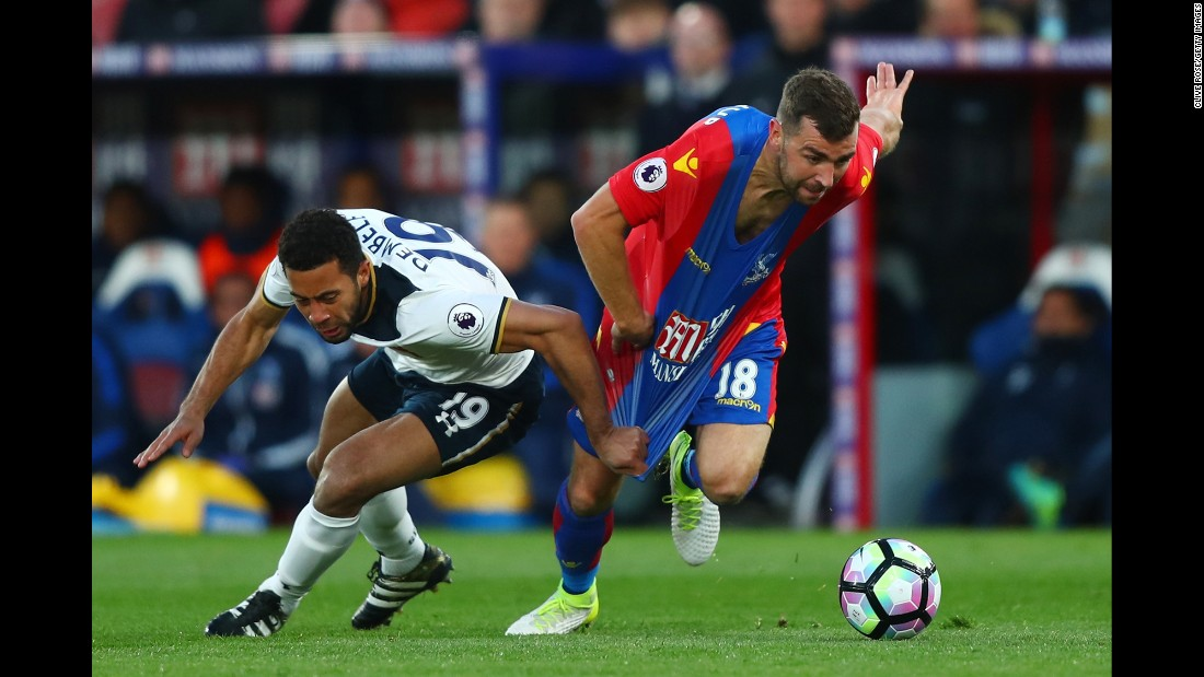 Tottenham midfielder Mousa Dembele pulls the shirt of Crystal Palace's James McArthur during a Premier League match in London on Wednesday, April 26.