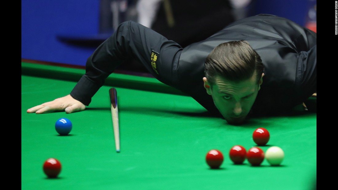 Mark Selby studies a shot Sunday, April 30, during the final of the World Snooker Championship.