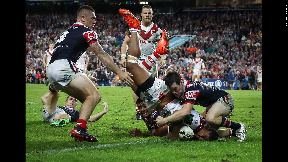 Nene Macdonald scores a try for the St. George Illawarra Dragons during a National Rugby League match against the Sydney Roosters on Tuesday, April 25. Sydney won 13-12.