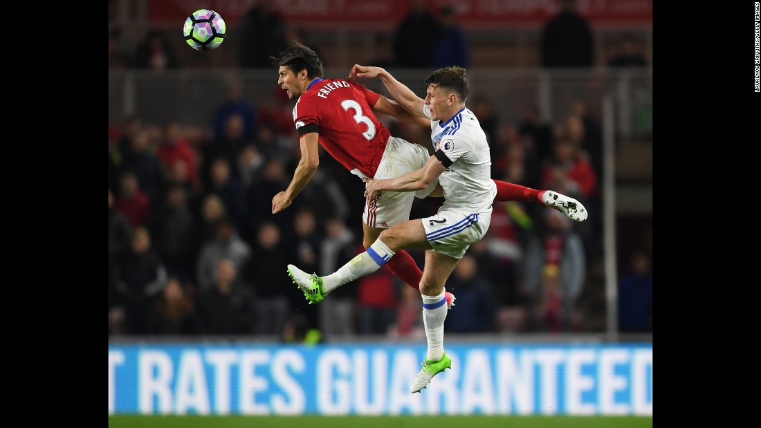 Middlesbrough's George Friend and Sunderland's Billy Jones compete for a ball during a Premier League match in Middlesbrough, England, on Wednesday, April 26.