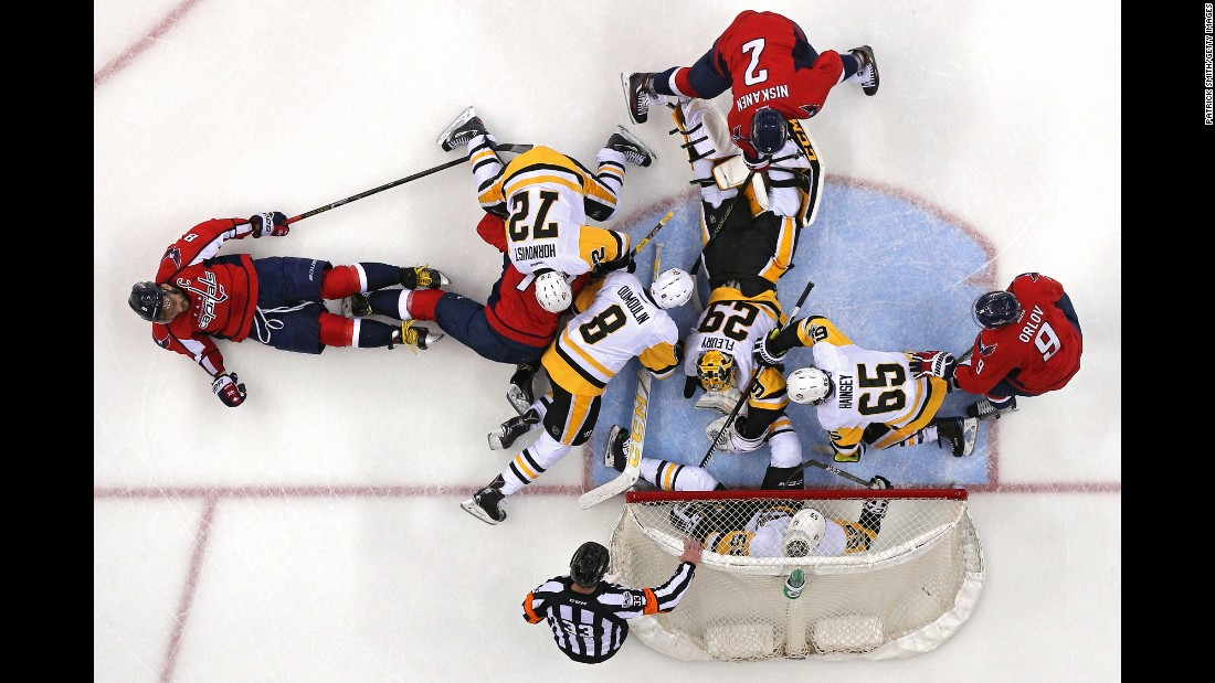 Pittsburgh goalie Marc-Andre Fleury (No. 29) makes a save during a goalmouth scramble in Washington on Thursday, April 27. Fleury and the Penguins took Game 1 of their second-round playoff series.