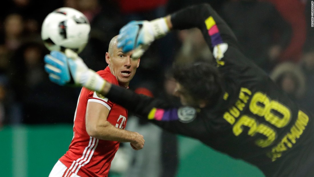 Bayern Munich's Arjen Robben tries to score past Dortmund goalkeeper Roman Burki during a German Cup semifinal on Wednesday, April 26. Dortmund won 3-2.