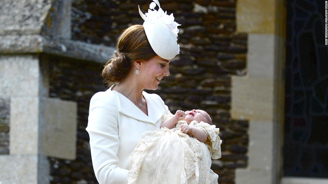 Charlotte is carried by her mother as they arrive for her christening.